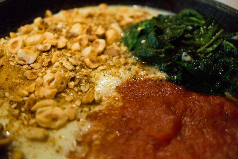 The Turkish Baked Eggs served with spicy tomato sauce, spinach, and ...