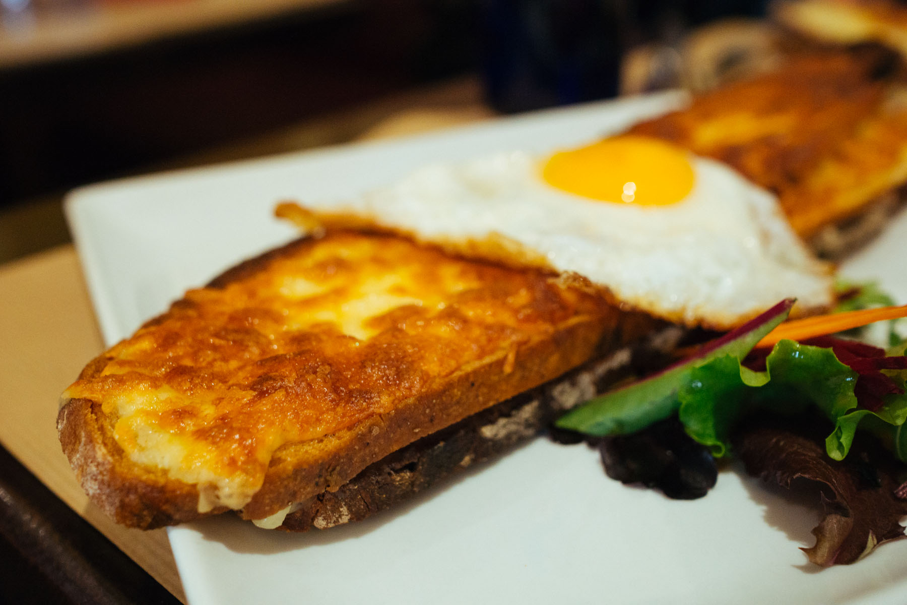 Croque Madame – grilled ham and cheese sandwich with a fried egg on ...